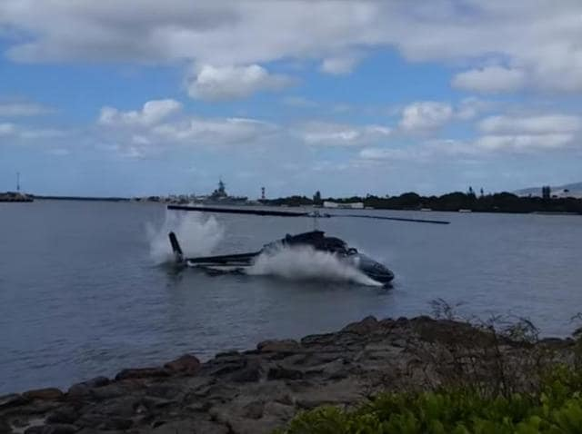 The moment the helicopter fell into the Pearl harbour