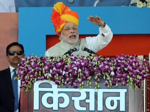 Prime Minister Narendra Modi addressing a farmers convention at Sherpur village in Sehore district where he launched a Prime Minister Crop Insurance scheme.