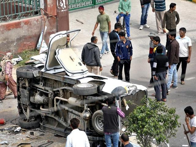 Jat students damaged a car outside the IGP's office in Rohtak.