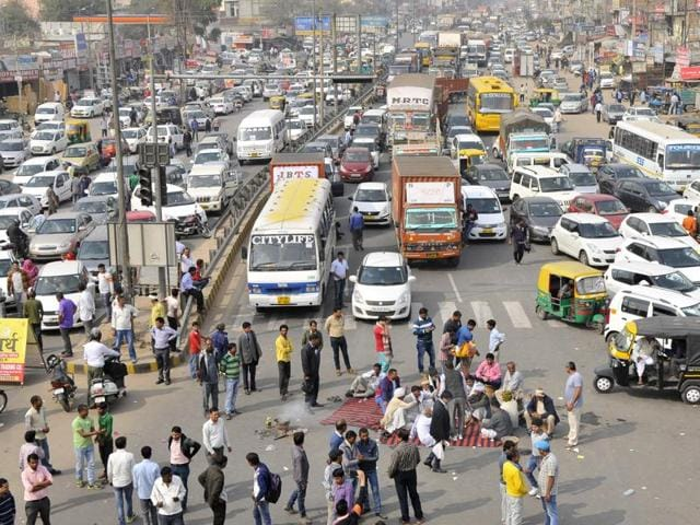 Protesters block the roads at Bakhtawar Chowk, Gurgaon, on Friday.