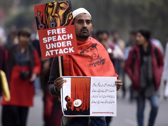 A protester carries a poster during a march demanding  release of JNUSU president Kanhaiya Kumar, in New Delhi on Thursday.