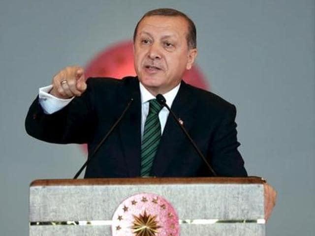Turkish President Tayyip Erdogan delivers a speech during a meeting in Ankara, Turkey.