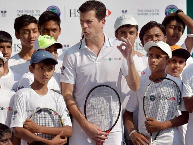 Former British tennis player Tim Henman giving tips to young tennis players at the MSLTA, during a press conference for the