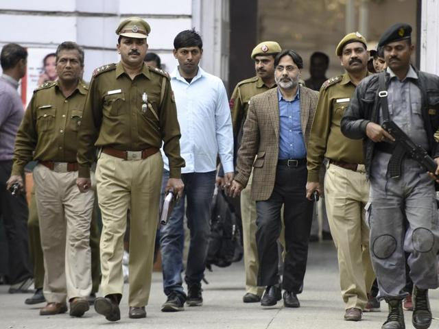 Delhi Police officers with SAR Geelani, former Delhi University lecturer, who was booked for sedition for allegedly organising an event marking the death anniversary of Parliament attack convict Afzal Guru at the Press Club of India.