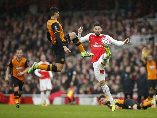 Arsenal's Olivier Giroud in action with Hull City's Curtis Davies during the FA Cup fifth-round match at the Emirates Stadium.