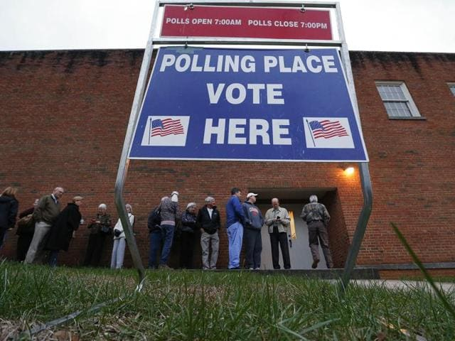 Voters wait in line for a polling place to open at Eastlan Baptist Church in Greenville, South Carolina.