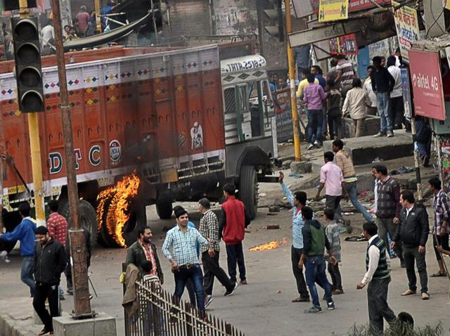 Protesters vandalised and damaged vehicles during quota protest in Rohtak.