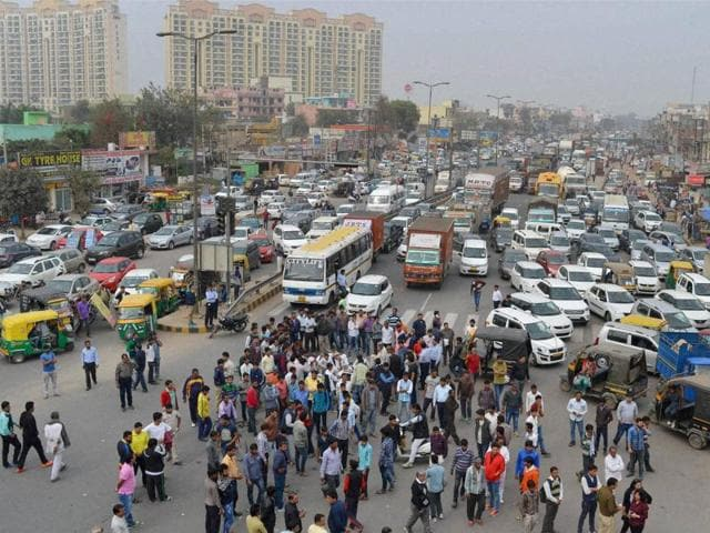 People of Jat community block the Gurgaon- Alwar National Highway near Netaji Subhash Chandra Bose Chowk in Gurgaon.