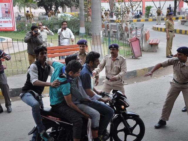 Police try to stop Jat community members who turned violent during their agitation for reservation in Rohtak on Friday.