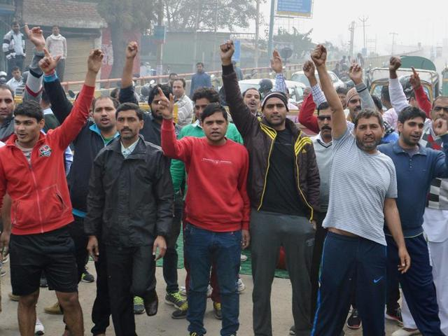 Protesters demanding reservations for the Jat community block the Gurgaon- Alwar National Highway near Netaji Subhash Chandra Bose Chowk in Gurgaon on Friday.