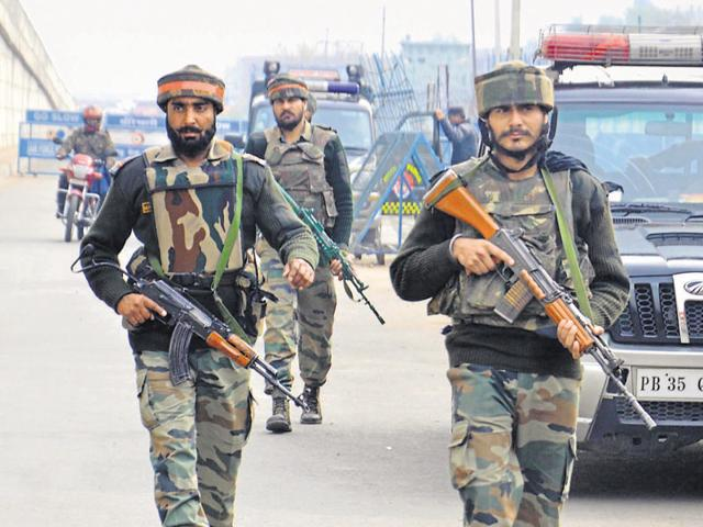 Indian Army soldiers stand guard at the air force base at Pathankot during a search operation in Punjab. Investigators are waiting to ascertain if there were four or six militants in the terror attack, sources said.