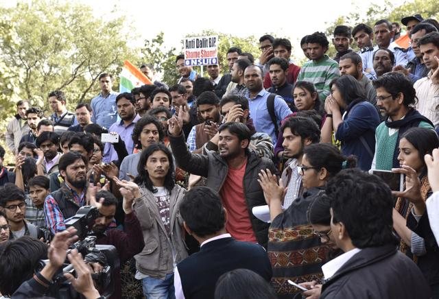 JNU student leader Kanhaiya Kumar (centre) and other students at a protest before the former's arrest in New Delhi