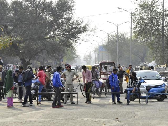 Protesters demanding reservation for Jats block roads at Maharana Pratap Chowk in Gurgaon on Saturday.