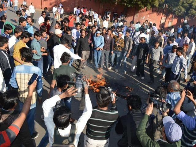 Ambedkar Vichar Manch activists torch an effigy of the Union government in Gwalior on Sunday.