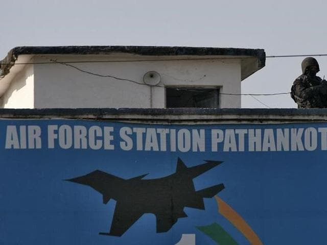 A soldier stands guard on a building at the Indian Air Force (IAF) base at Pathankot.