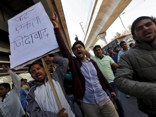 Demonstrators from the Jat community shout slogans during a protest in New Delhi.