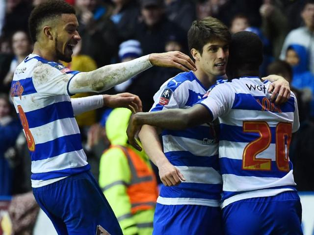 Reading's Lucas Piazon, Michael Hector and Ola John celebrate after the game.