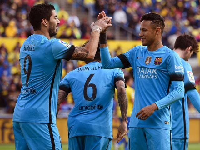 Barcelona's Luis Suarez celebrates a goal with  Neymar during the match against UD Las Palmas.