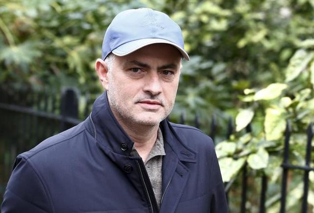 Former Chelsea soccer club manager Jose Mourinho walks near to his home in London.