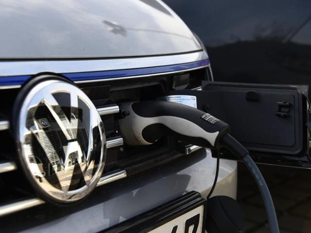 A VW electric car is plugged on a power station at a Service station in Berlin.