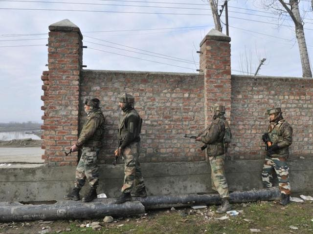 Security personnel at the site of the gunbattle with militants in Pampore, J-K on Sunday.