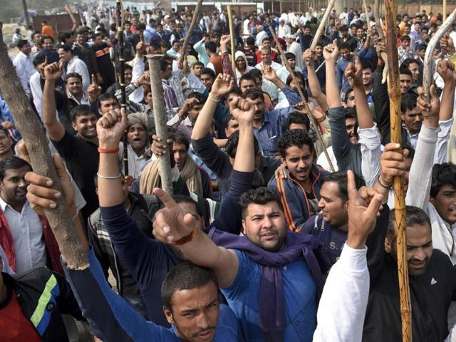 Members of the Jat community shout slogans in Bahadurgarh to press for their demand of quota in government jobs.