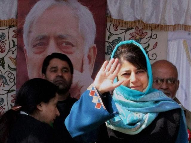 PDP chief Mehbooba Mufti greets party workers during a meeting in Srinagar.