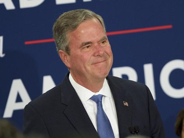 Former Florida governor Jeb Bush announcing his end in the Republican race for the White House in Columbia, South Carolina on Saturday, accompanied by with his wife, Columba, son Jeb Bush Jr. (left), and senator Lindsey Graham.