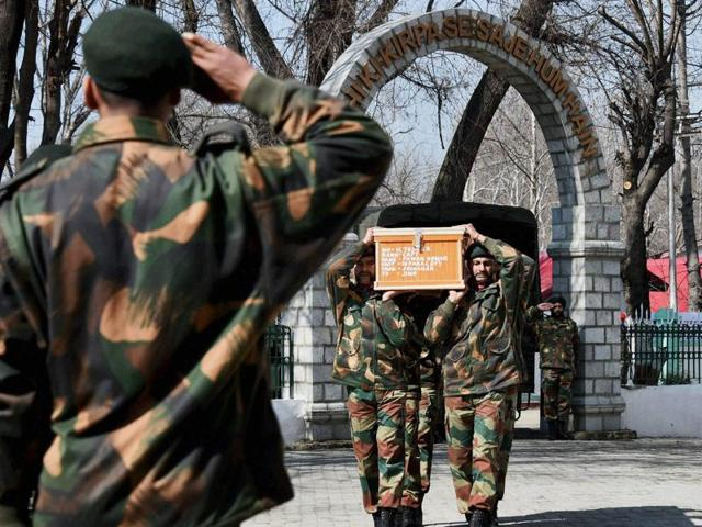Soldiers carry the body of Captain Pawan Kumar who died during a gun battle with militants in Srinagar.