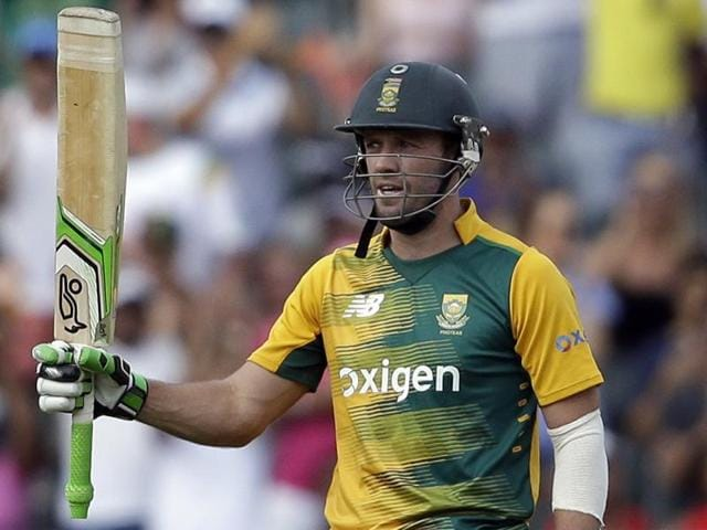 South Africa's AB de Villiers raises his bat after reaching his half-century during the second and the final T20 against England at the Wanderers Stadium in Johannesburg on February 21, 2016.