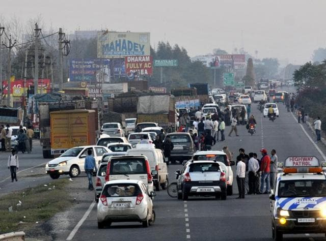 The traffic on both sides of the highway was stuck at Panchkula in Haryana for more than six hours because the road was obstructed by Jat agitators .