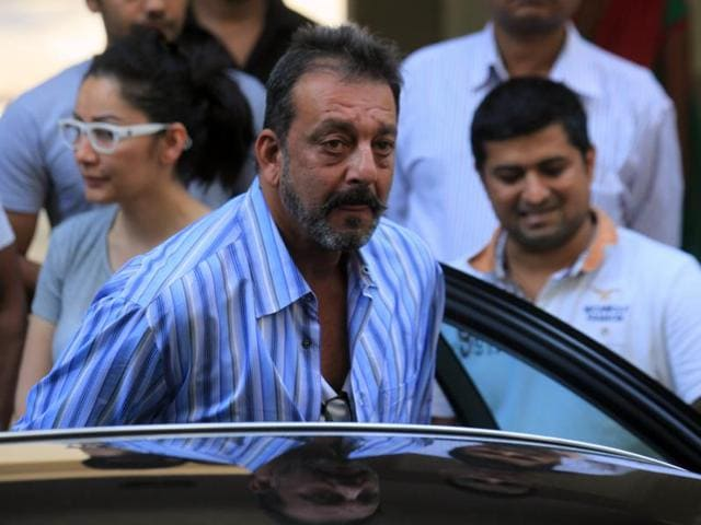 Bollywood actor Sanjay Dutt with his wife Manyata as he leaves his residence to return to jail last year.