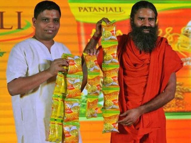 Yoga guru Ramdev and Acharya Balkrishna pose during the launch of Patanjali Atta Noodles.