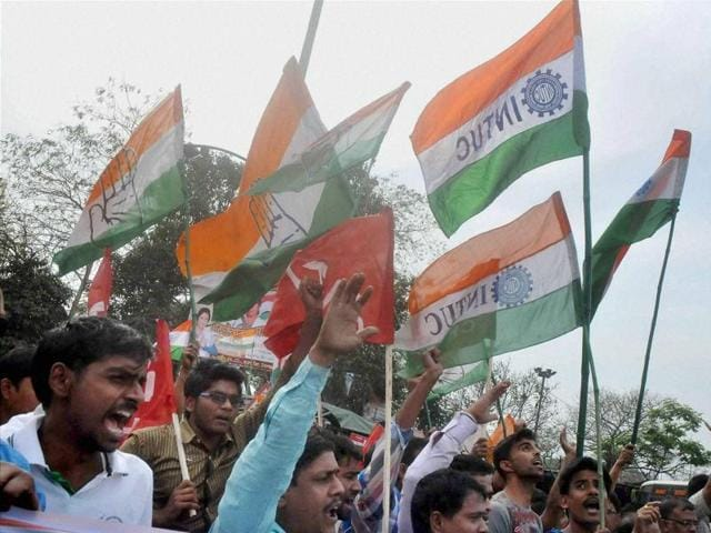 Congress party workers burn an effigy of RSS chief Mohan Bhagwat during their