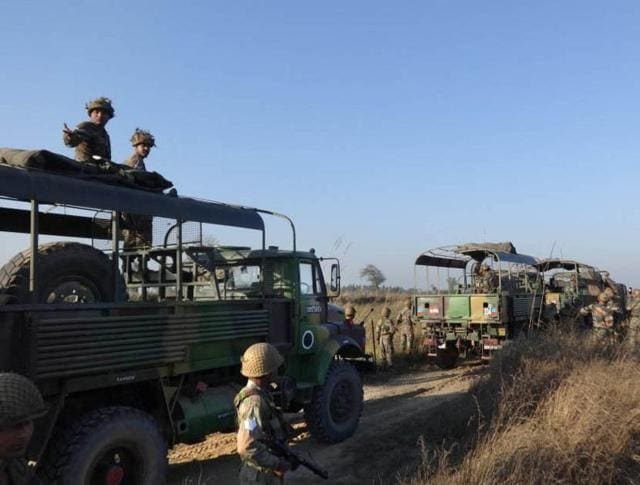Army personnel head near Munak Canal in Karnal,  Haryana, on Sunday