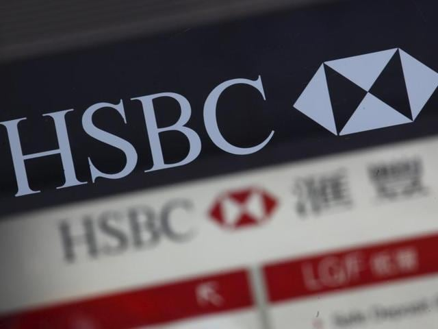 An HSBC logo is displayed at the entrance of its branch in Hong Kong.