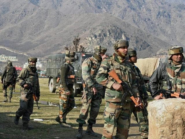 Indian Army soldiers take position near the site of gun battle in the outskirts of Srinagar. A handful of terrorists holed up in a building exchanged fire with security forces for the third-straight day.