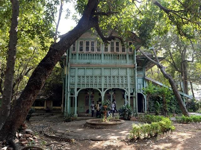 Students gather under the porch of the Kipling Bunglow - the birthplace of author Rudyard Kipling - inside the campus of the JJ School of Art in Mumbai.