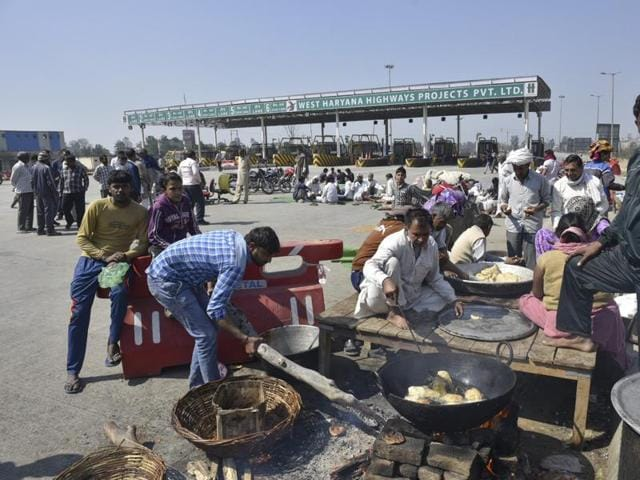 Jat quota protestors at the Rohtak road in Sampla on Monday.