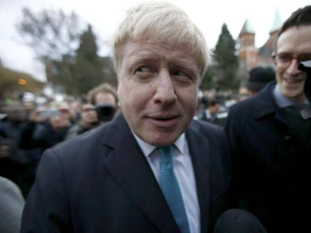 London mayor Boris Johnson speaks to the media in front of his home in London.