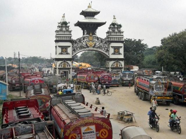 In this file photo, Nepalese oil tankers and commercial trucks stand stranded near a gate that marks the Nepalese border with India in Birgunj.