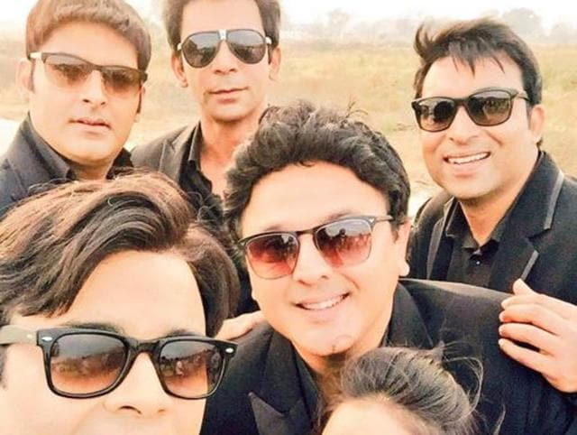 In the pictures, Kapil, Sunil Grover, Sumona Chakravarthi, Ali Asgar, Kiku Sharda and Chandan Prabhakar are seen hanging out on a deserted road with the crew.