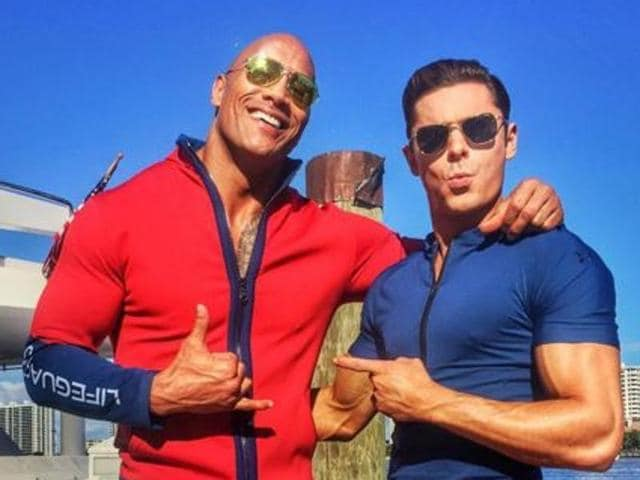 The 43-year-old semi-retired professional WWE wrestler was joined by fellow co-star Zac Efron.
