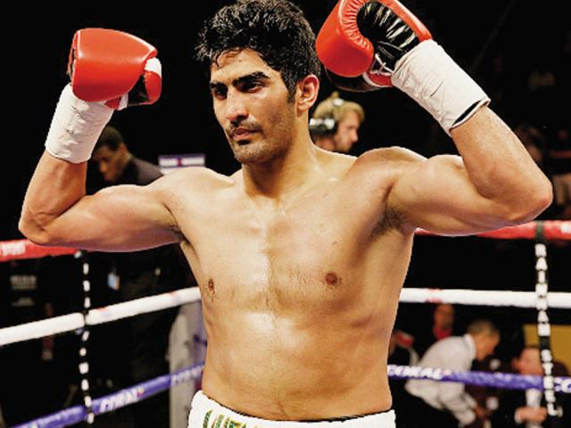 Vijender Singh celebrates after defeating Sonny Whiting of Great Britain during their Middleweight contest.