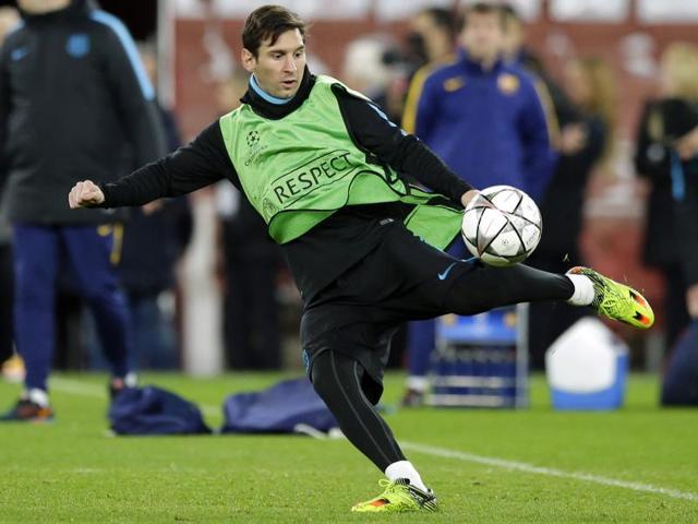 Barcelona's Luis Suarez, Javier Mascherano and Gerard Pique, attend a training session at Emirates Stadium.
