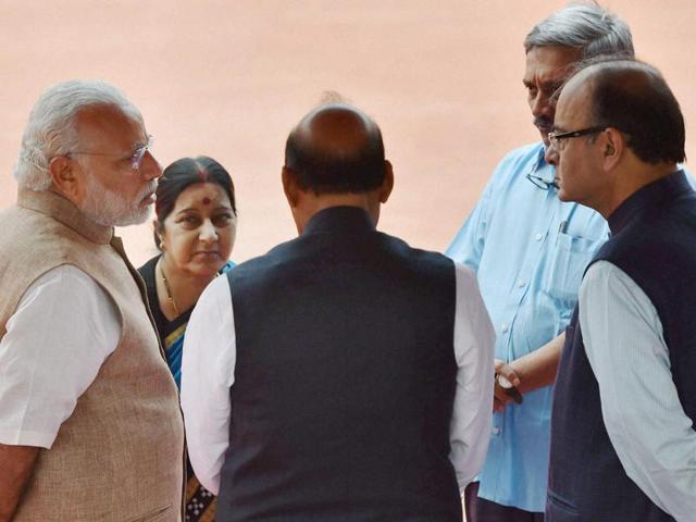 Prime minister Narendra Modi with home minister Rajnath Singh, external affairs minister Sushma Swaraj, finance minister Arun Jaitley and defence minister Manohar Parrikar at Rashtrapati Bhavan in New Delhi .