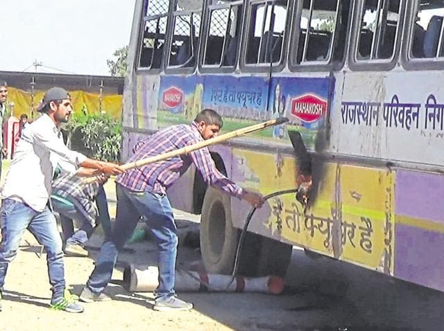 Jat protesters damage a bus at Sewar.