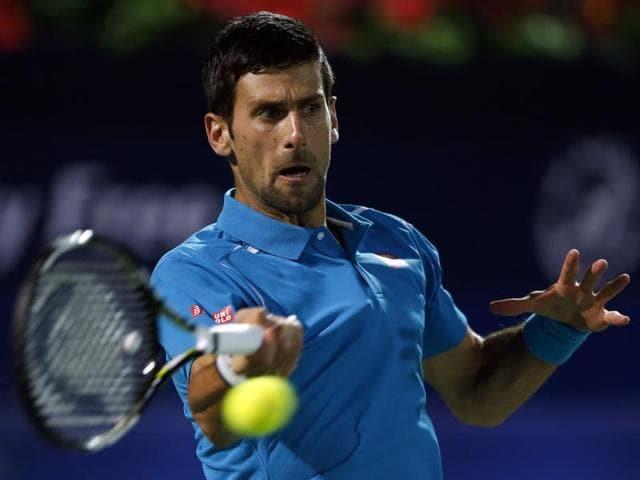 Novak Djokovic returns the ball to Tommy Robredo during their ATP tennis match.