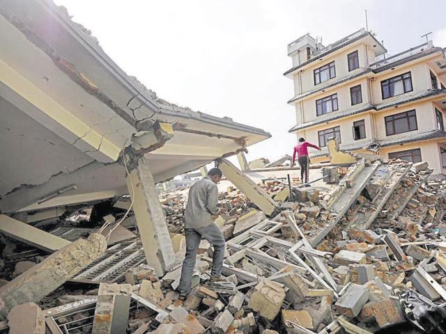 (Left) Debris at Durbar Square after  the Nepal earthquake on April 25, 2015. (Right) a man walks by the same place after the debris were cleared in  March 2, 2016.