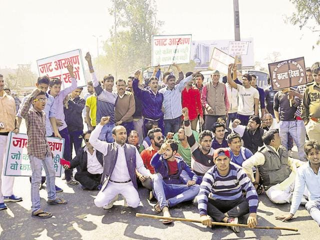 Jat protesters block the road at Shapla village as they protest demanding reservation in government services, in Haryana, India, on Monday(Hindustan Times)